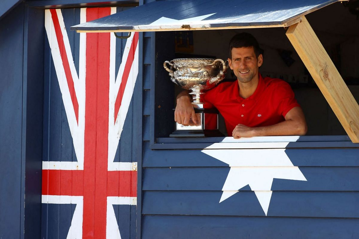 Serbia's Novak Djokovic poses with the Norman Brookes Challenge Cup trophy during a photo shoot at the Brighton Beach in Melbourne on Feb 22, 2021, a day after his victory over Russia's Daniil Medvedev in their men's singles final match of the Austra