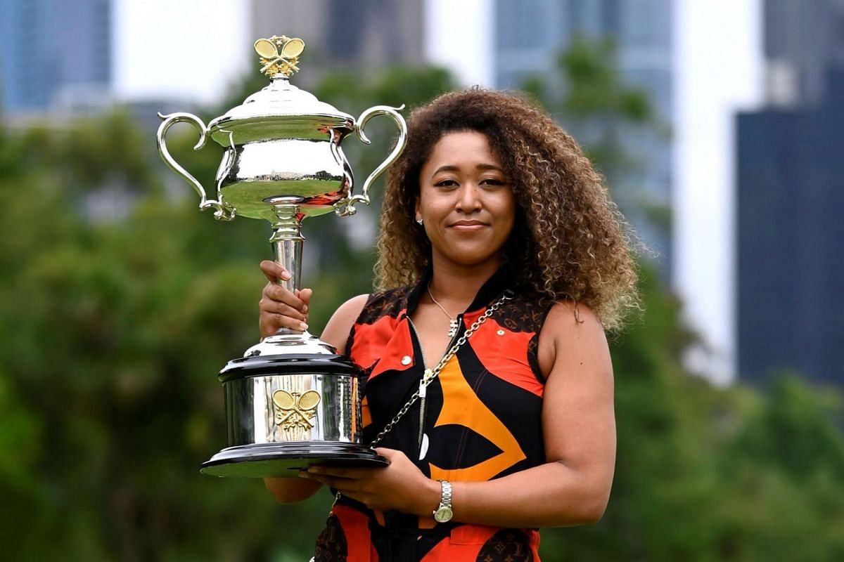 Australian Open champion Japan's Naomi Osaka poses with the trophy during a photo shoot at the Royal Botanic Gardens Victoria in Melbourne, Australia, on Feb 21, 2021.