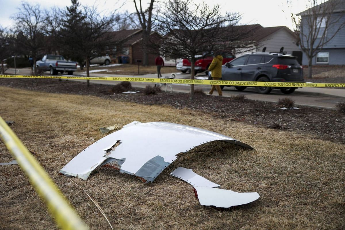 Pieces of an airplane engine from Flight 328 sit scattered in a neighborhood on Feb 20, 2021 in Broomfield, Colorado. An engine on the Boeing 777 exploded after takeoff from Denver prompting the flight to return to Denver International Airport where