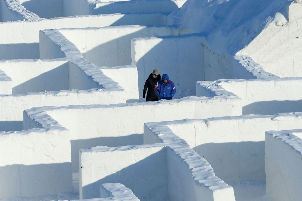 People navigate through a giant snow maze which was proclaimed the world's largest by Guinness World Records, in St. Adolphe, Manitoba, Canada, Feb19, 2021.