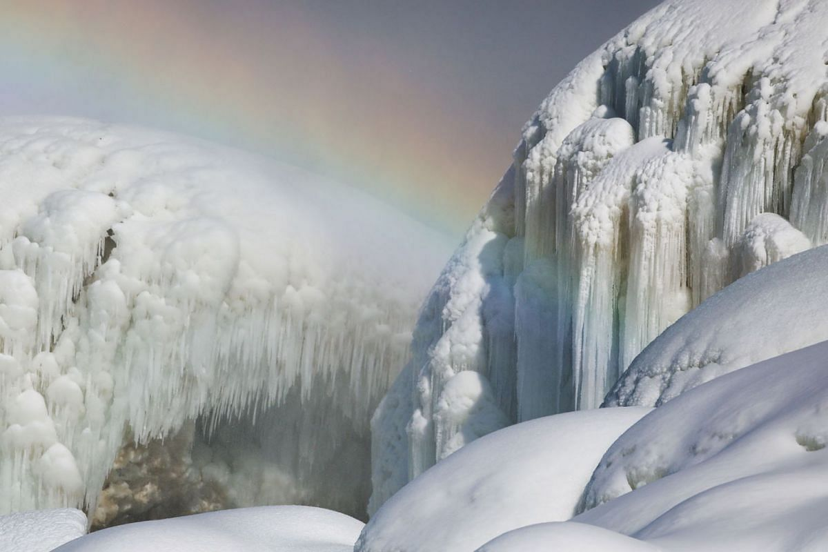 Ice sits at the base of the American Falls due to cold temperatures in Niagara Falls, New York, U.S., Feb 21, 2021.
