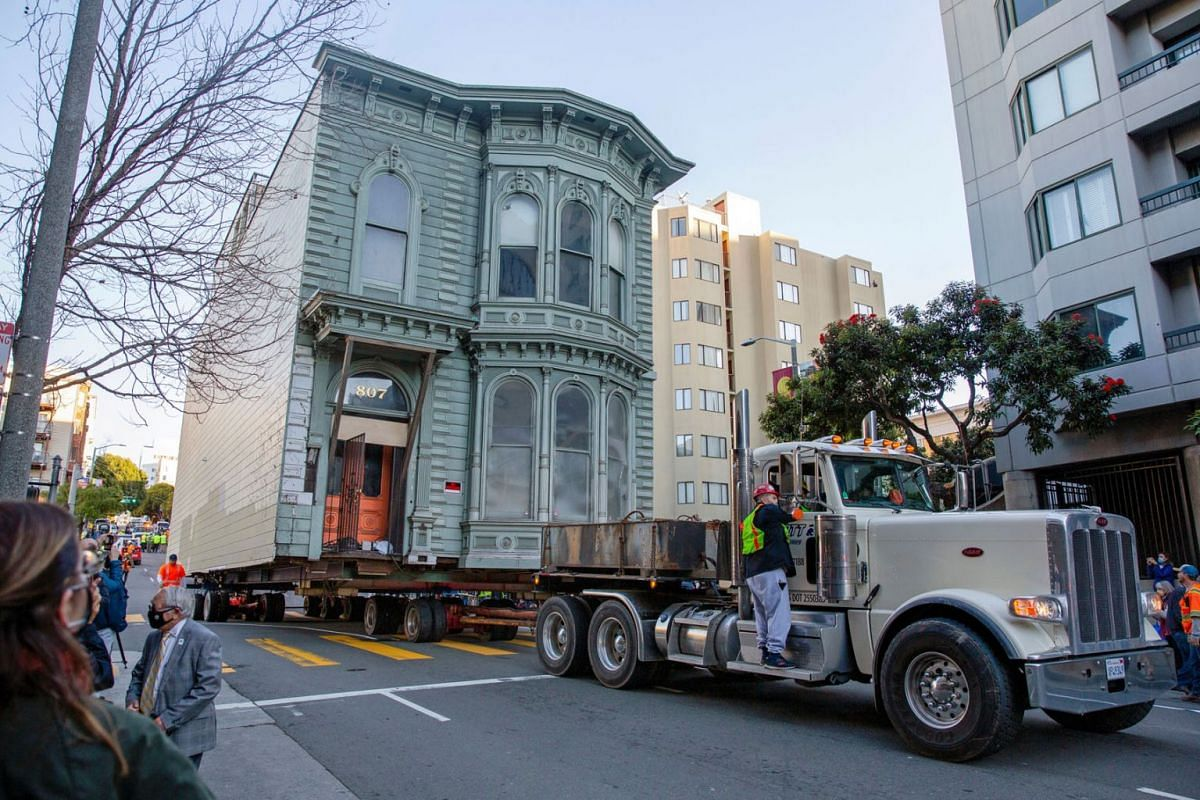 The 139-year-old Victorian house known as the Englander House is hoisted on a flat bed and pulled down Franklin Street towards its new location six blocks away, as the original site is to be used to build a 48-unit, eight-story apartment building, in