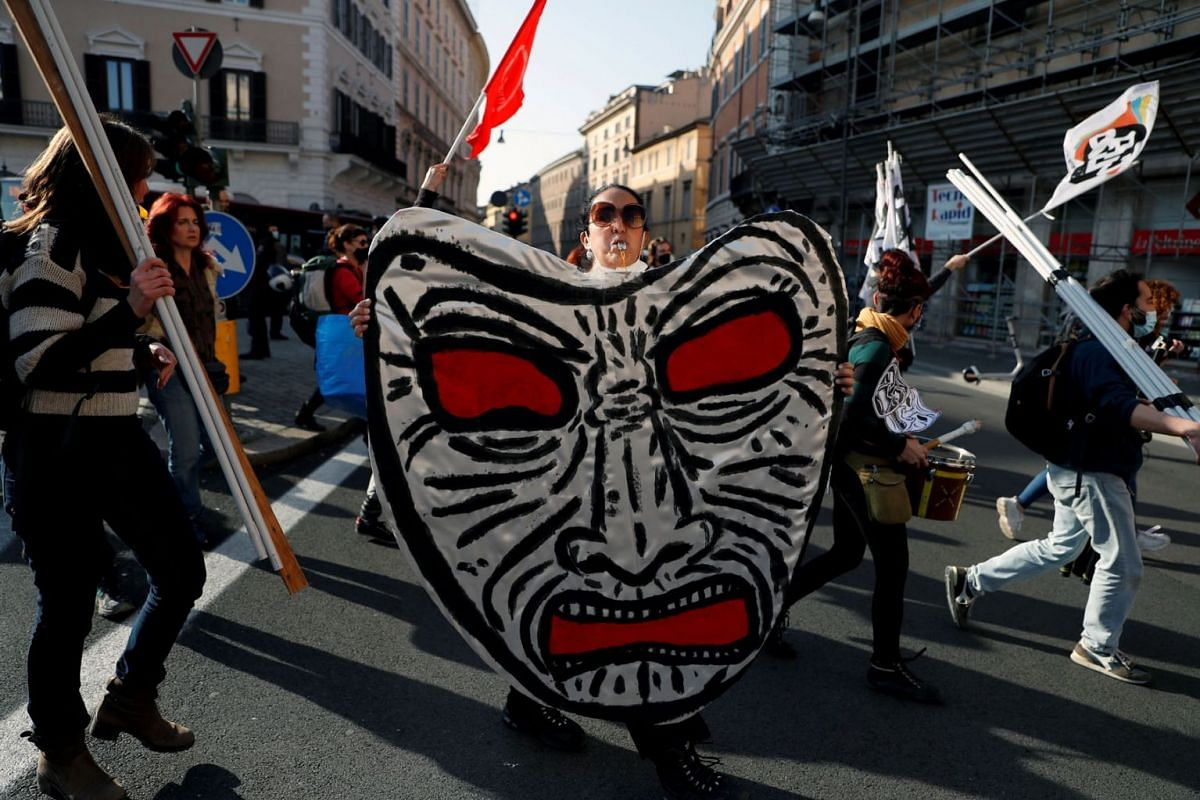 Workers from the entertainment industry hold a demonstration against the government's Covid-19 restrictions and to demand the reopening of cinemas and theatres, outside a theatre, in Rome, Italy, Feb 23, 2021.