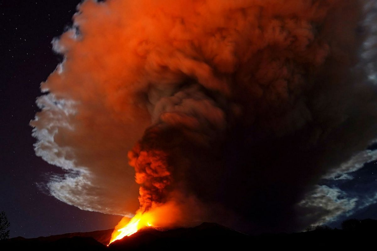 Large streams of red hot lava shoot into the night sky as Mount Etna, Europe's most active volcano, continues to erupt, as seen from the village of Fornazzo, Italy, Feb 23, 2021.