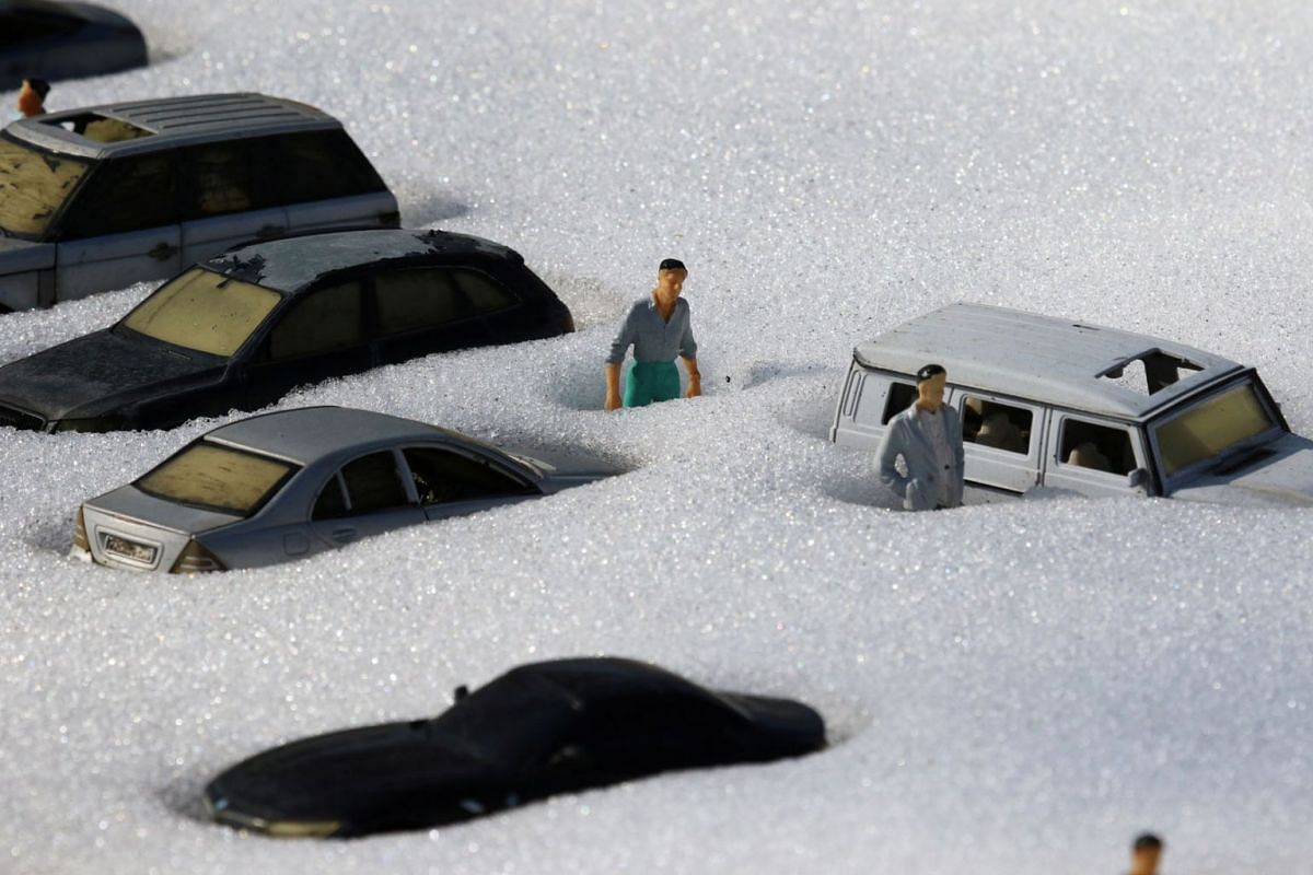 Snow covered figures are pictured at a local park of miniatures in Bakhchisaray, Crimea, Feb 23, 2021.