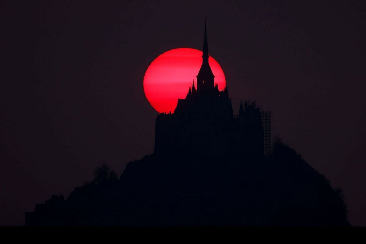 The iconic Mont Saint-Michel is seen at sunset in the western region of Normandy, France, on March 8, 2021.