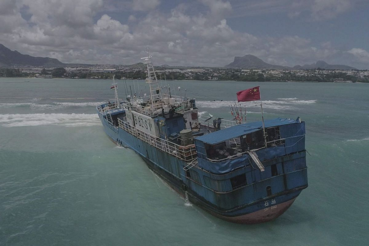 An aerial view taken on March 8, 2021, shows Chinese fishing vessel Lurong Yuan Yu that ran aground on reefs of Pointe-aux-Sables in Port Louis, Mauritius, on March 7, 2021.