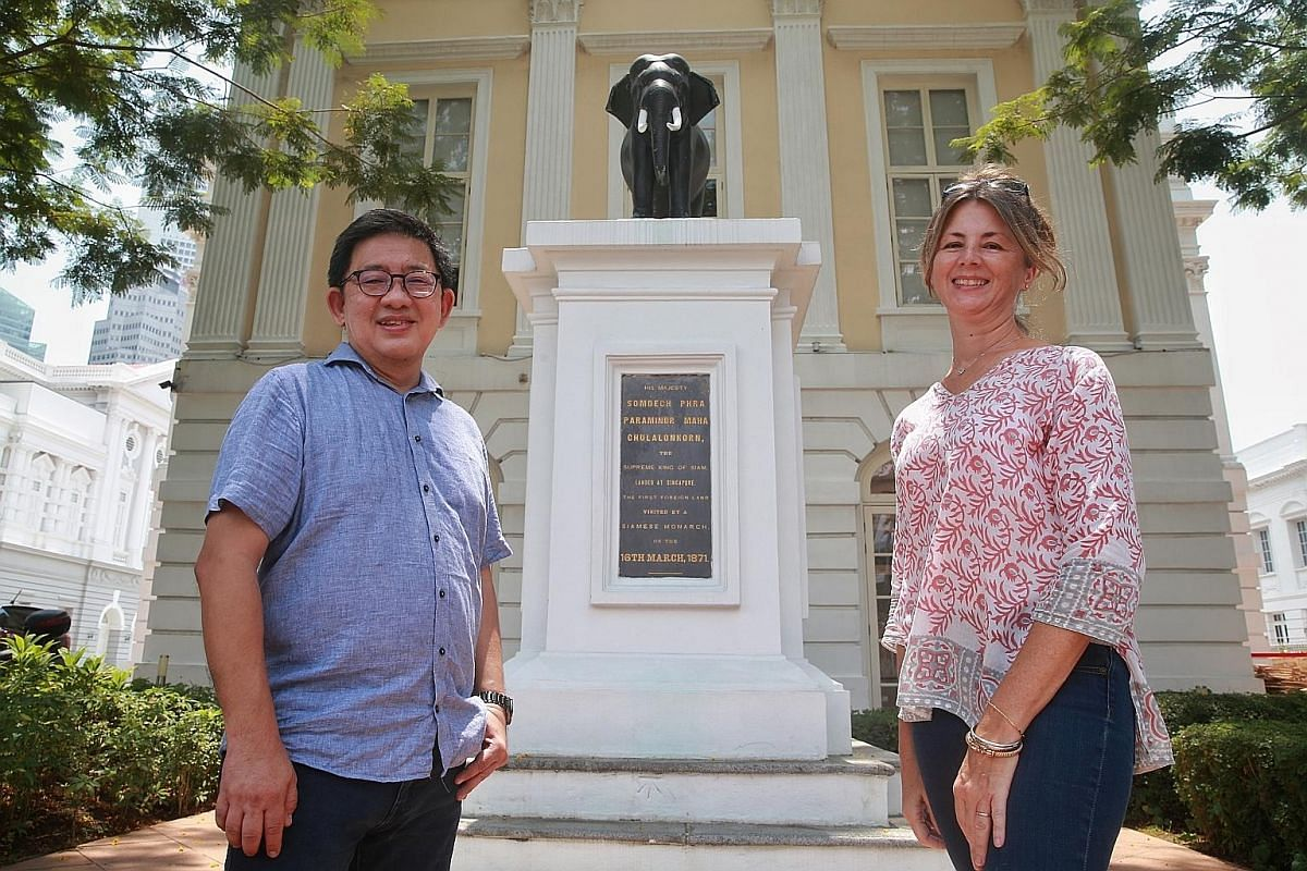 Secret Singapore's (above) authors Jerome Lim (top left) and Heidi Sarna (top right) in front of the elephant statue at Old Parliament House.