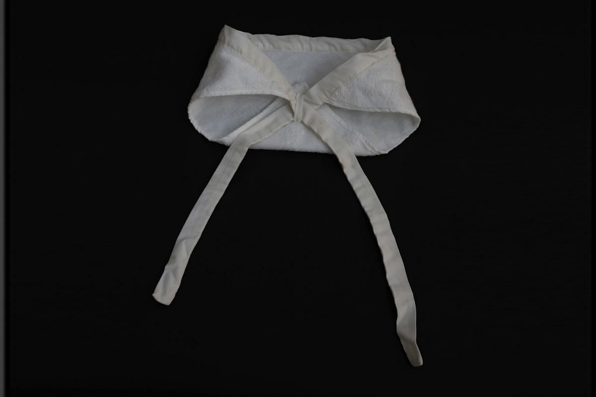 TERRY-TOWEL BABY NAPPY: In the 1960s and 1970s, seamstresses from the SGH linen room used to sew these terry-towel baby nappies that were worn by neonates in the paediatrics department. During periods of long stretches of wet weather or insufficient