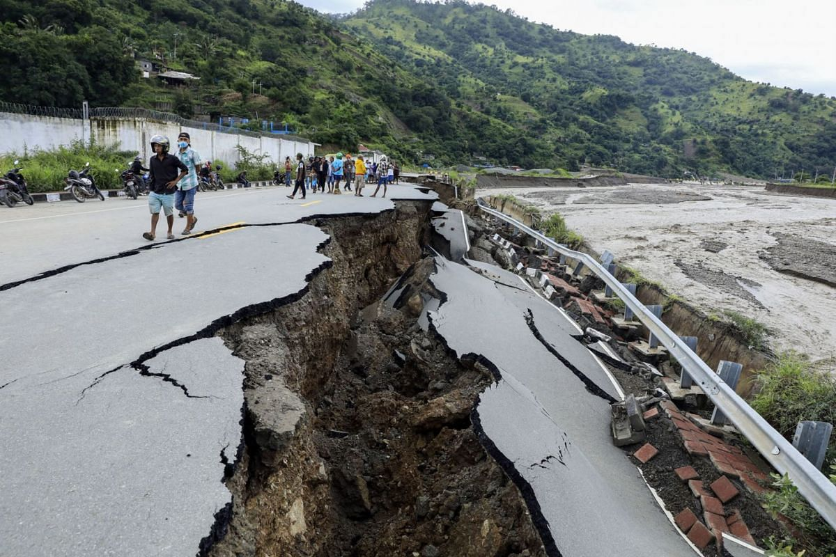 A damaged road in the aftermath of floods in Dili, East Timor, also known as Timor Leste, on April 5, 2021.