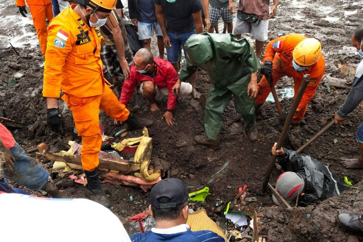 Indonesia rescue agency search for a body at an area affected by flash floods after heavy rains in East Flores, East Nusa Tenggara province, Indonesia, on April 5, 2021.