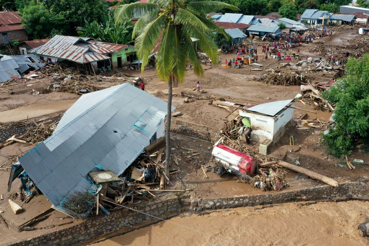 An aerial picture shows damaged houses affected by flash floods after heavy rains in East Flores, East Nusa Tenggara province, Indonesia, on April 6, 2021, in this photo taken by Antara Foto.