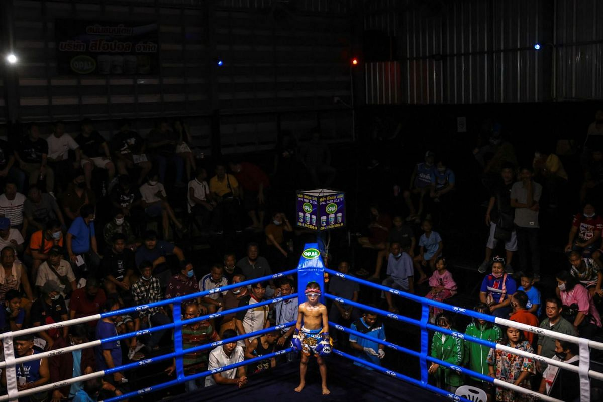 Pornpattara Peachurai wears a face shield as he stands before his boxing match at a temporary boxing ring in Chachoengsao province, Thailand, October 26, 2020.