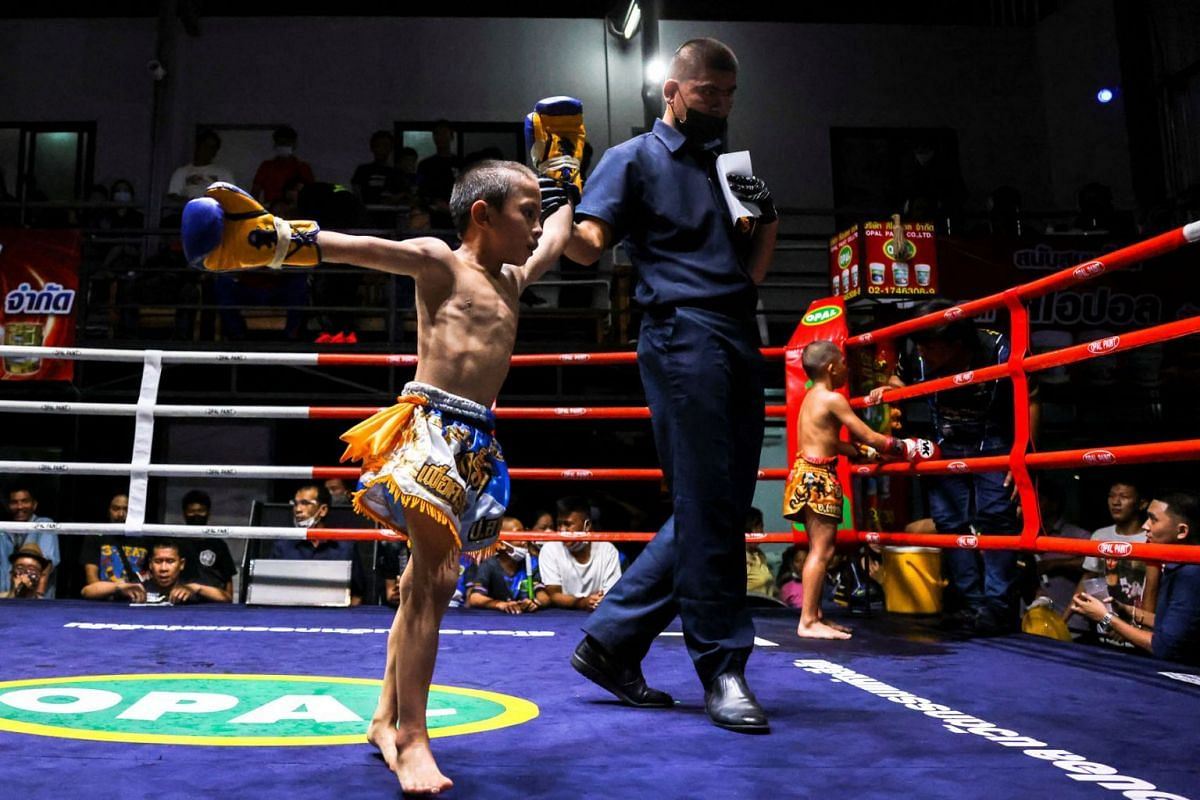 Pornpattara Peachurai celebrates after winning a boxing match at a temporary boxing ring in Chachoengsao province, Thailand, October 26, 2020.