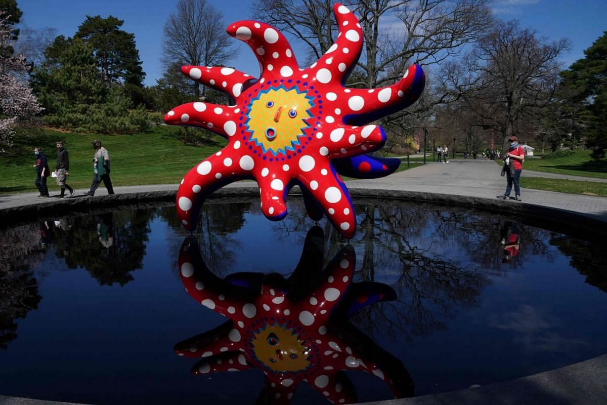 """Japanese artist Yayoi Kusama's """"I Want to Fly to the Universe"""" on display during the KUSAMA: Cosmic Nature Media Preview on April 7, 2021 at the New York Botanical Garden in the Bronx borough of New York City."""