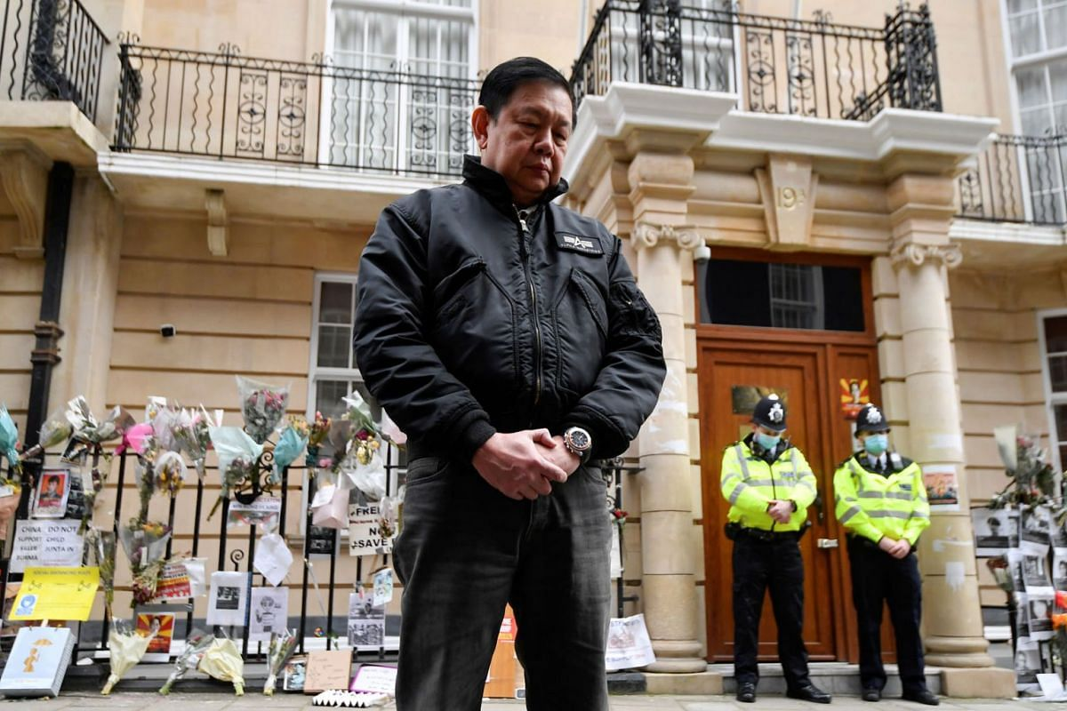 Myanmar's ambassador Kyaw Zwar Minn stands, after he was locked out of the embassy, and sources said his deputy had shut him out of the building and taken charge on behalf of the military, outside the Myanmar Embassy in London, Britain, on April 8, 2