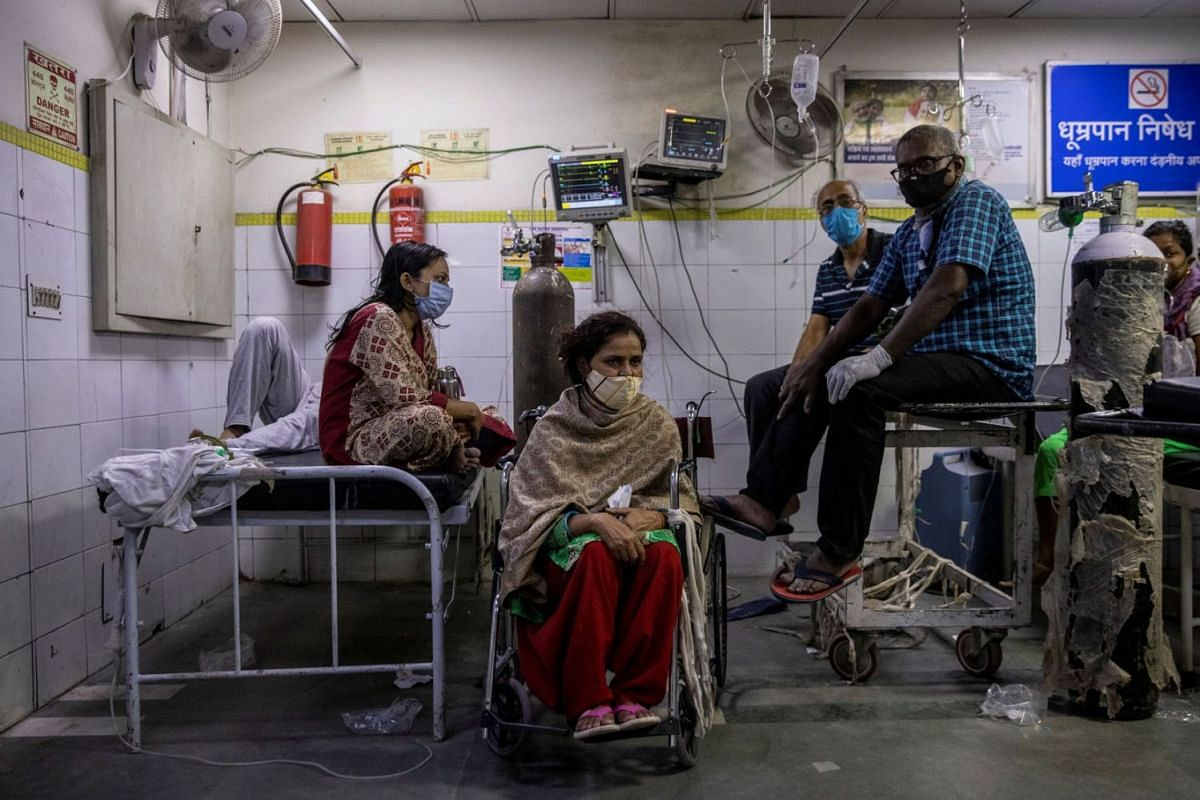Patients suffering from Covid-19 get treatment at the casualty ward in Lok Nayak Jai Prakash hospital in New Delhi, India on April 15, 2021.