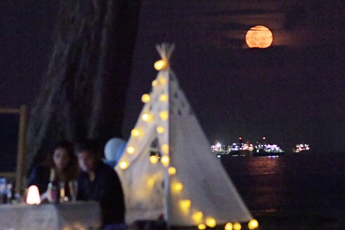 The supermoon as seen from East Coast Park on April 27, 2021.