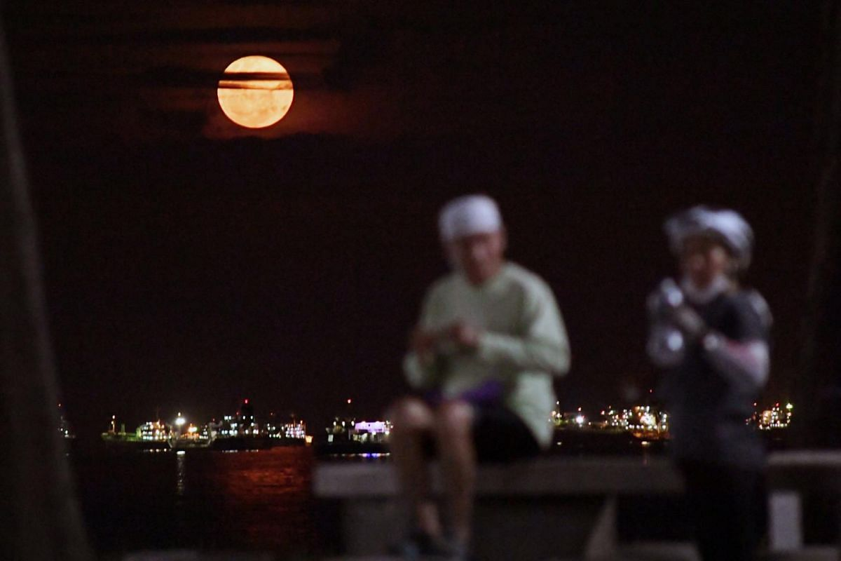 The supermoon as seen from East Coast Park in Singapore on April 27, 2021.