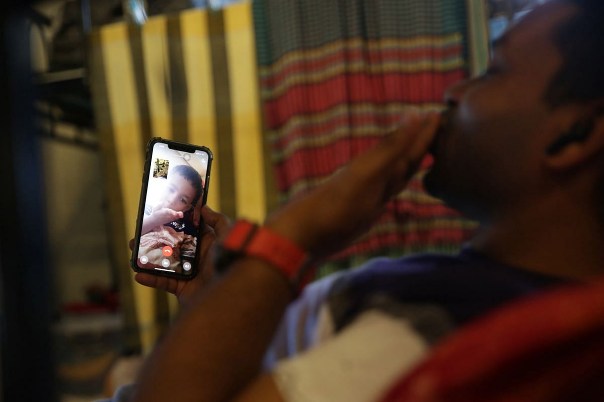 Mr Rafique exchanging kisses with his three-year-old son, Arham Khan Mihim, via a video call on his rest day. He has a daughter, Mihika Alyna Raffa, who is 13 months old. He last saw his son in February last year but he has yet to see his daughter wh