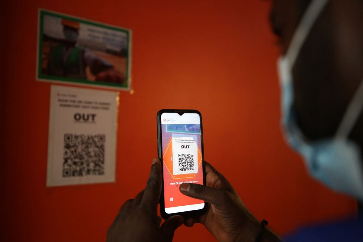 A migrant worker scanning his exit pass. Eligible workers will be able to book an exit pass via the SGWorkPass mobile application to visit their dormitory's assigned recreation centre (RC), up to seven days in advance. Checks will be conducted by dor
