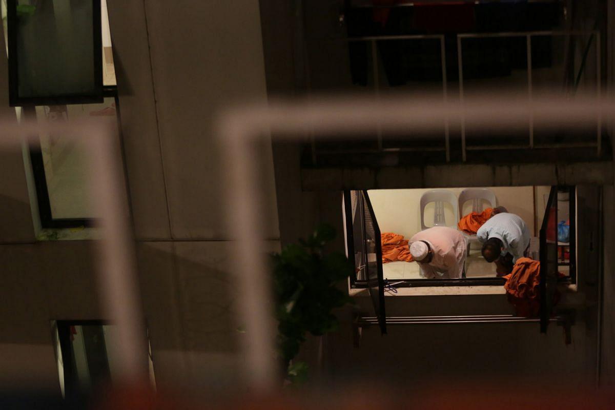 Migrant workers seen praying at the Greyform dormitory along Kaki Bukit Road.