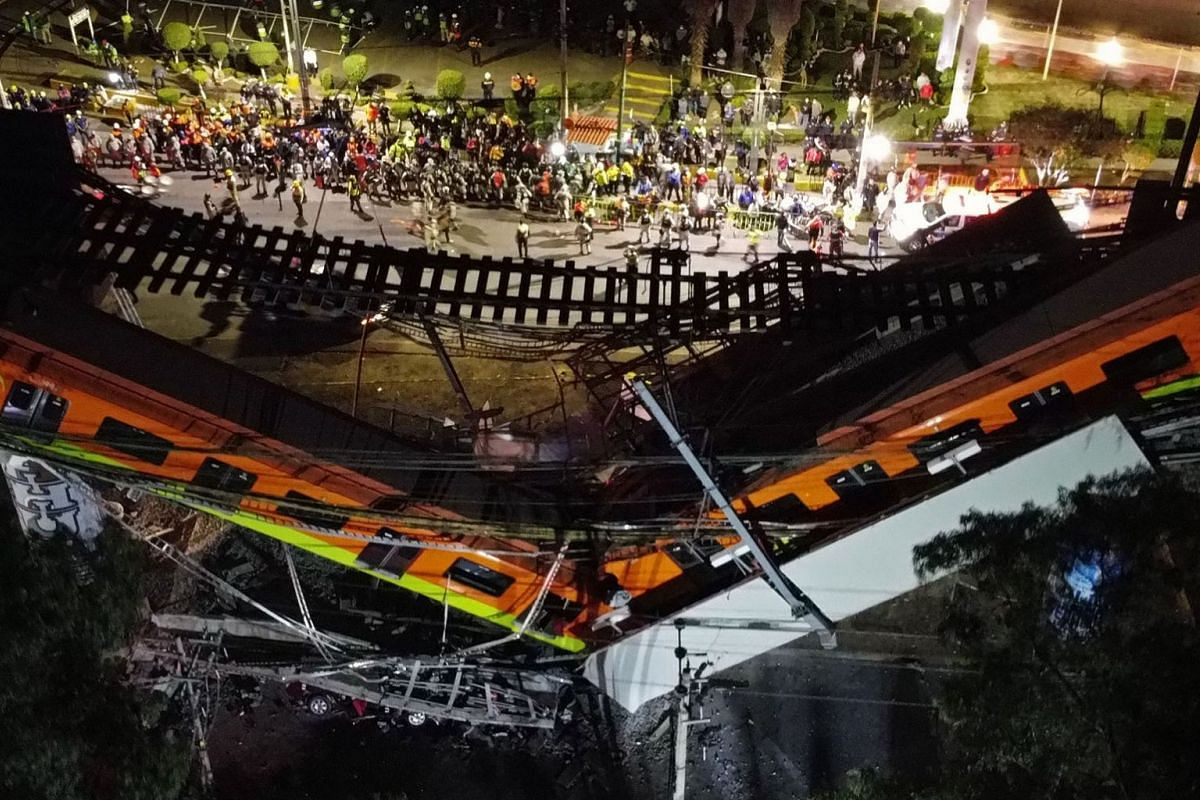 Aerial view taken with a drone shows the derailed Mexico City subway at the bridge between the Olivos and Tezonco stations, in Mexico City, Mexico, 04 May 2021.