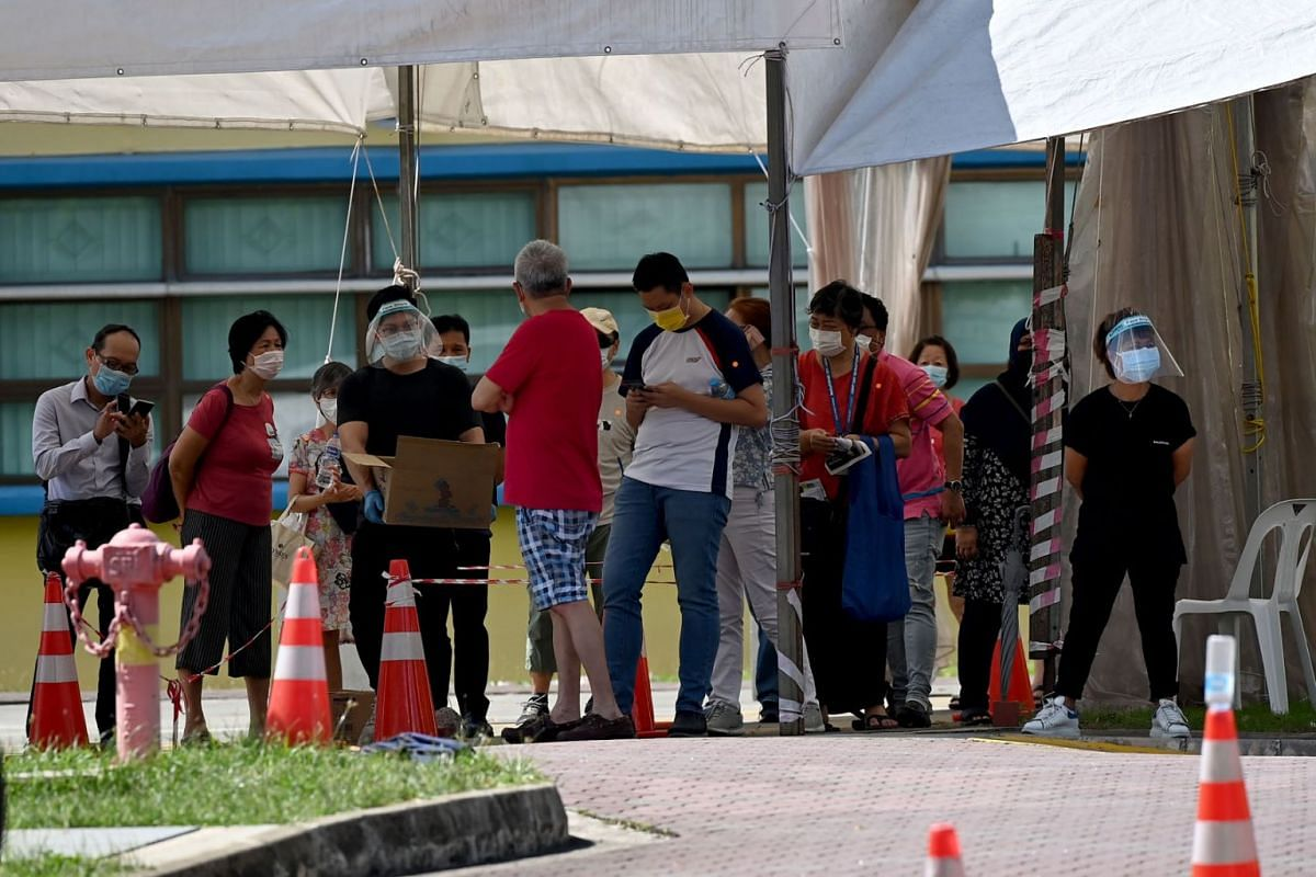 People who visited Tan Tock Seng Hospital (TTSH) seen at the swabbing centre at the former Coral Primary School at Pasir Ris Street 51 on May 3, 2021. Free Covid-19 testing was offered to those with possible exposure to the TTSH cluster.
