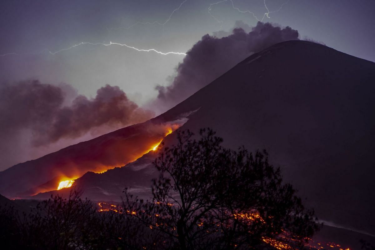 Lava flows from Guatemala's Pacaya Volcano as seen from Cerro Chino in San Vicente Pacaya municipality, south of Guatemala City, on May 2 ,2021.