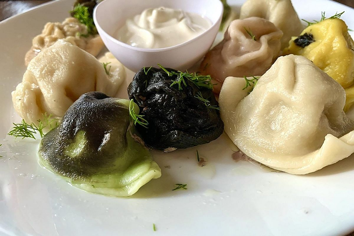Holy Cow! A Vegetarian Food Tour! includes a visit to a dried goods wholesale centre (above) to learn about ingredients in vegetarian cooking. Russian dumplings, or pelmeni, have fillings such as cheese and salmon. Twenty-two botanicals are used to m