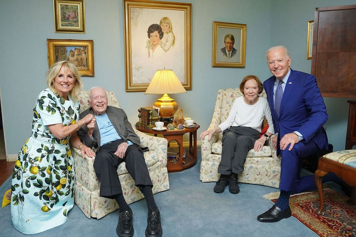 A photo provided by Adam Schultz/The White House shows former President Jimmy Carter and former first lady Rosalynn Carter, both seated, posing for a photo with President Joe Biden and first lady Jill Biden at the Carter's home in Plains, Ga. The pic