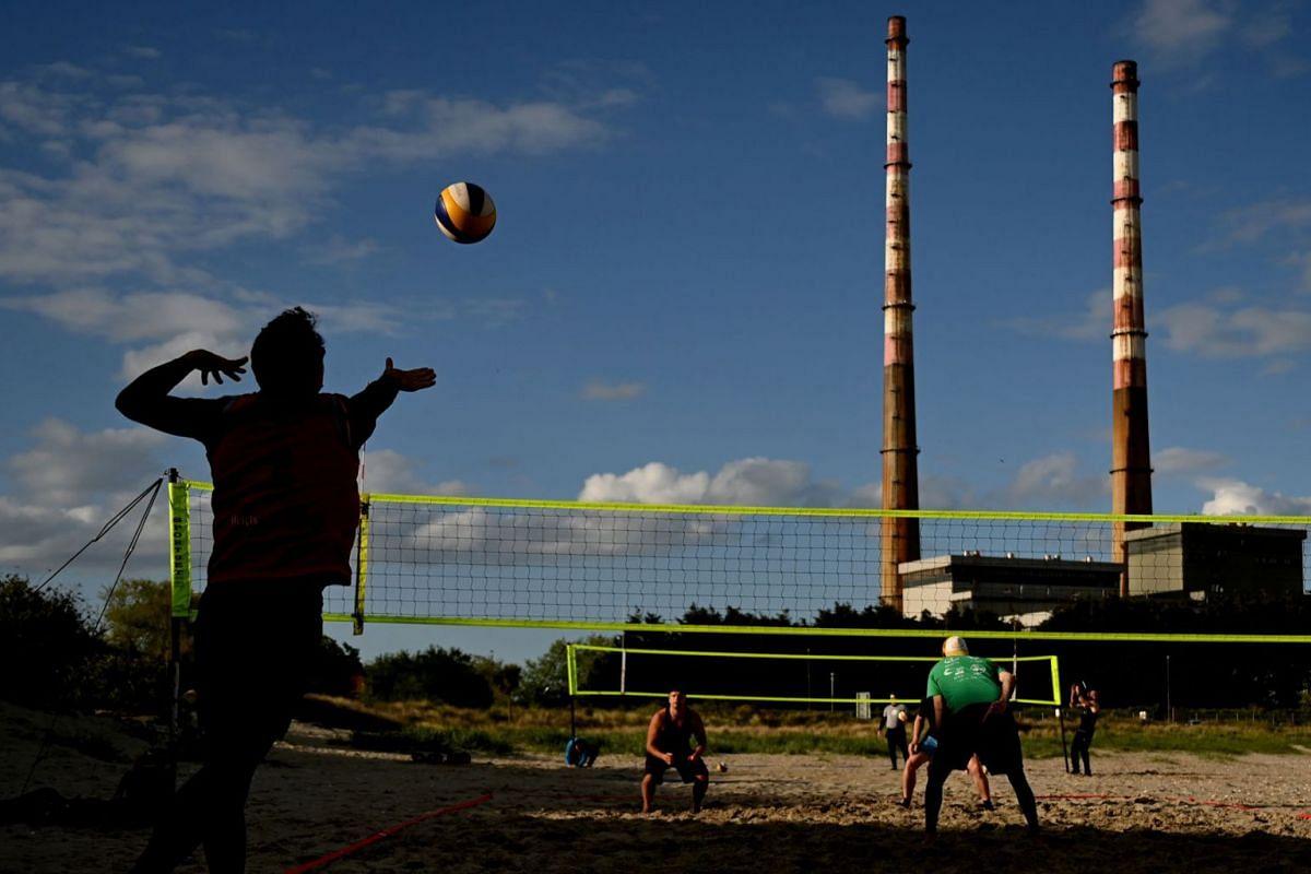 People play volleyball on Poolbeg beach amid the coronavirus disease pandemic, in Dublin, Ireland, May 6, 2021.