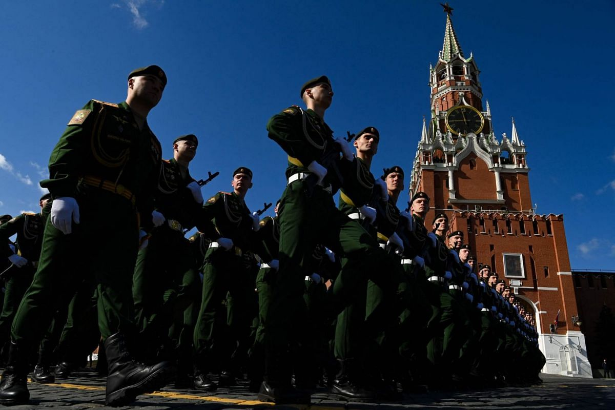 Russian servicemen gather at Red Square in Moscow on May 7, 2021, before a rehearsal for the Victory Day military parade.