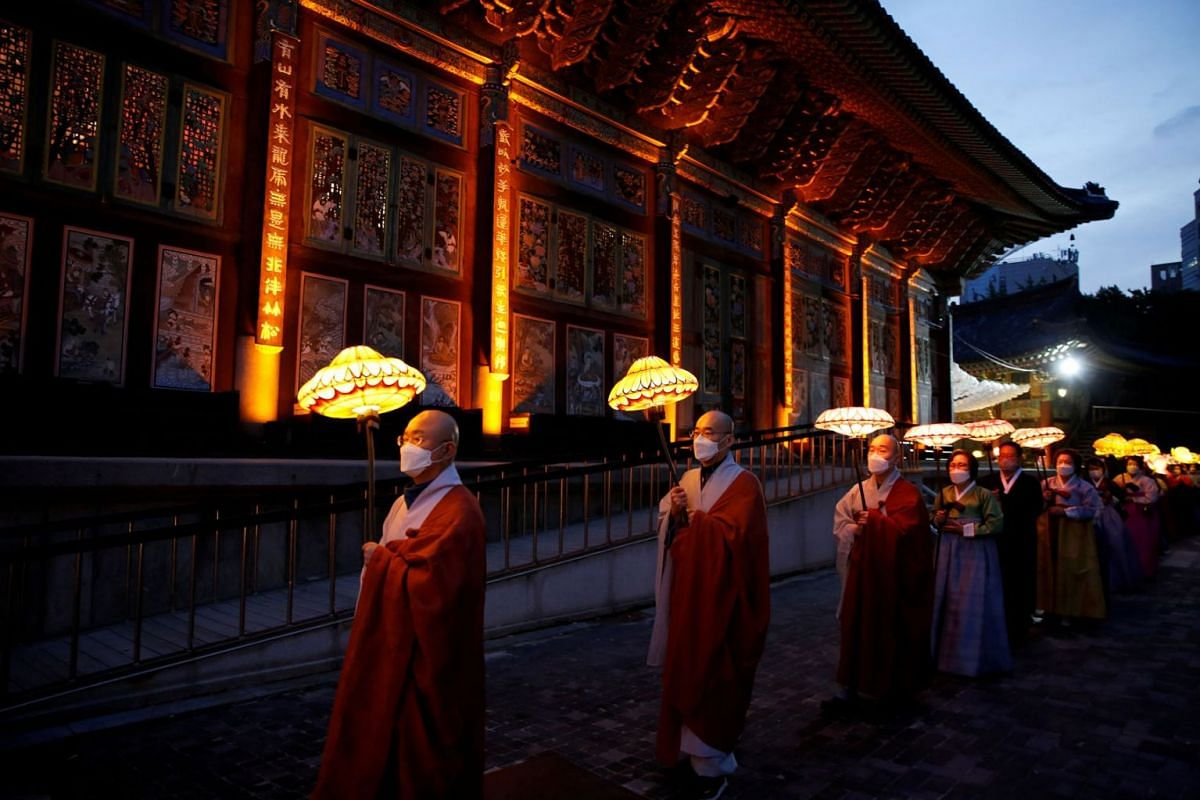Buddhist monks and believers attend a lantern parade in celebration of the upcoming birthday of Buddha at a temple in Seoul, amid the coronavirus disease pandemic, in Seoul, South Korea, May 6, 2021.