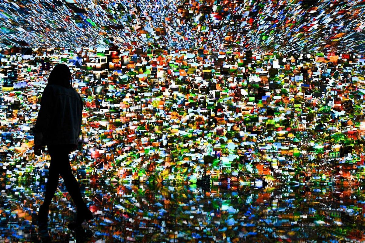 A person visits an art installation by Turkish-American media artist Refik Anadol at the Casa Batllo in Barcelona on May 6, 2021.