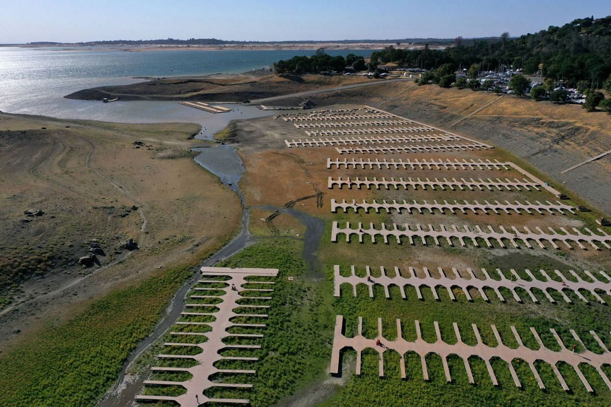 An aerial view shows boat docks at the Browns Ravine Cove sitting on dry earth at Folsom Lake on May 10, 2021 in El Dorado Hills, California.