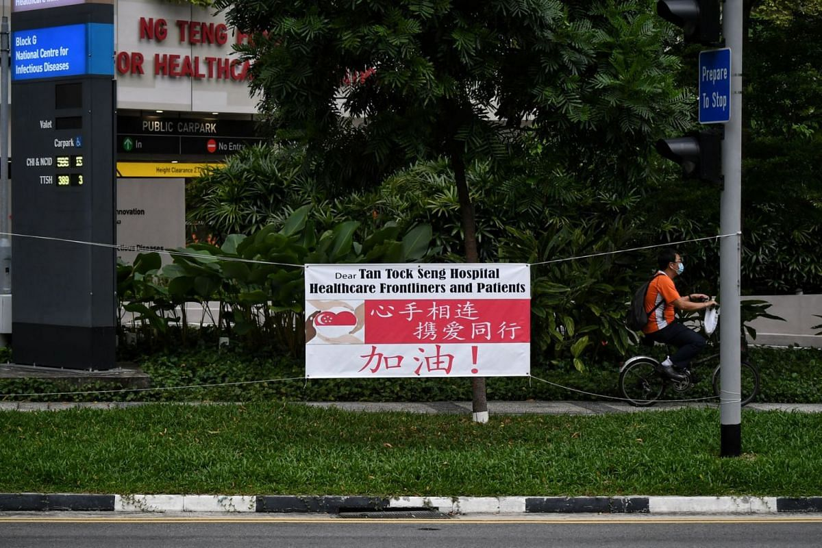A banner put up outside Tan Tock Seng Hospital to encourage and express support for staff and patients is seen on May 11, 2021. Health Minister Gan Kim Yong said that for every case detected, those around them were tested and isolated, and all wards