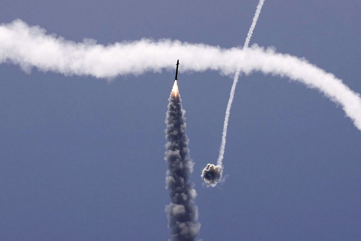 Israel's Iron Dome aerial defence system intercepts a rocket launched from the Gaza Strip, controlled by the Palestinian Hamas movement, above the southern Israeli city of Ashkelon, on May 11, 2021. Israel and Hamas exchanged heavy fire, in a dramati
