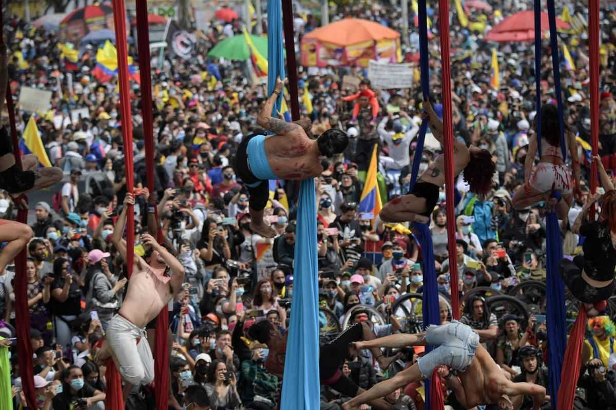 Artists perform as they take part in a protest against the government of Colombian President Ivan Duque, in Bogota on May 15, 2021.
