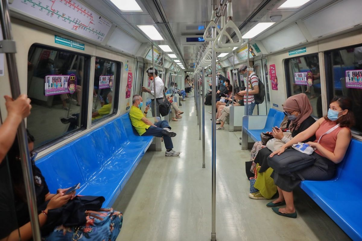 Commuters onboard an East-West Line MRT train at 8.30am, on May 17, 2021.
