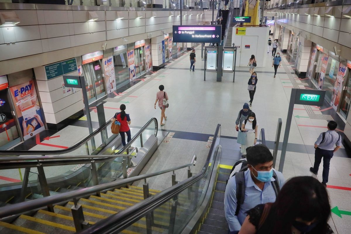 Commuters at Outram Park MRT station at 8.20am, on May 17, 2021.