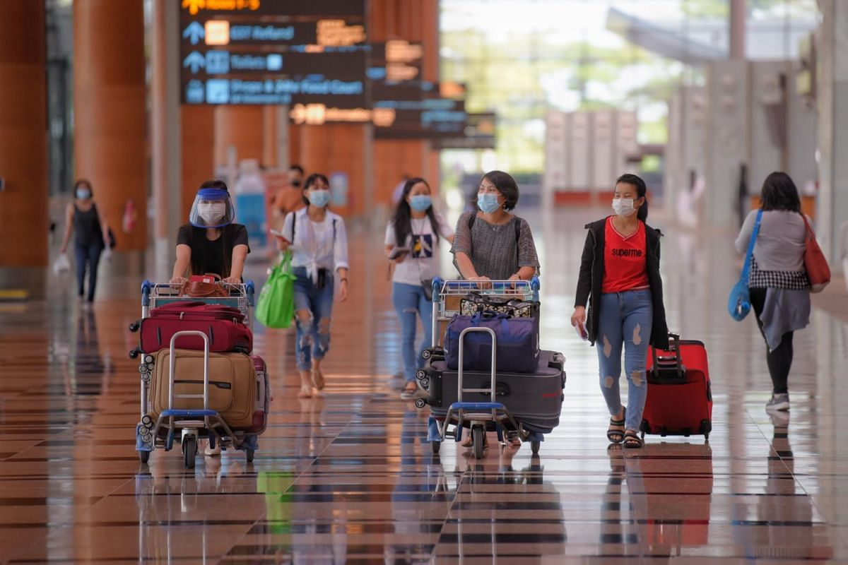 Travellers walking to the departure hall from Zone 3 on May 24, 2021.