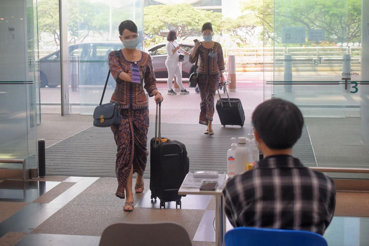 Flight crew entering the departure check-in area in Zone 3 from the drop-off area at Terminal 3 on May 24, 2021.