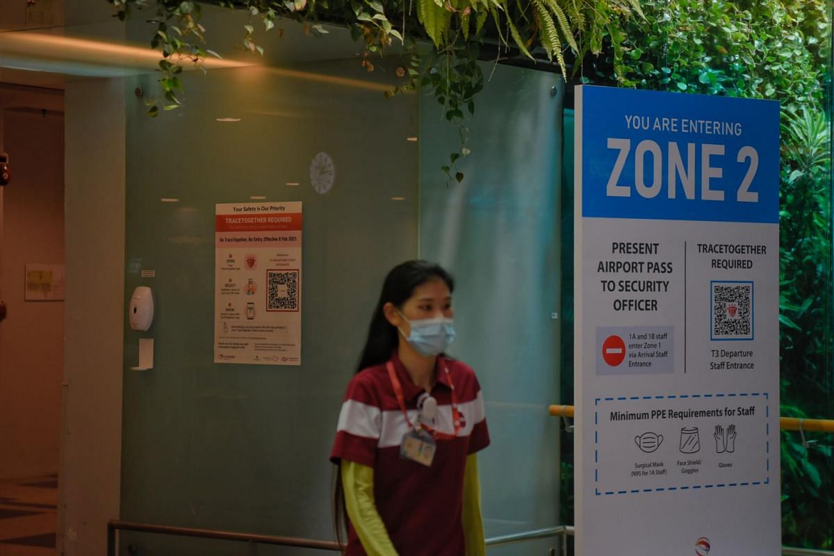 An airport worker entering Zone 2 at Changi Airport Terminal 3 on May 24, 2021.