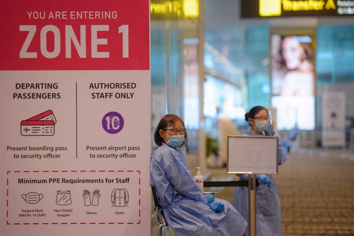 Changi Airport staff at Zone 1 of Terminal 3 on May 24, 2021.