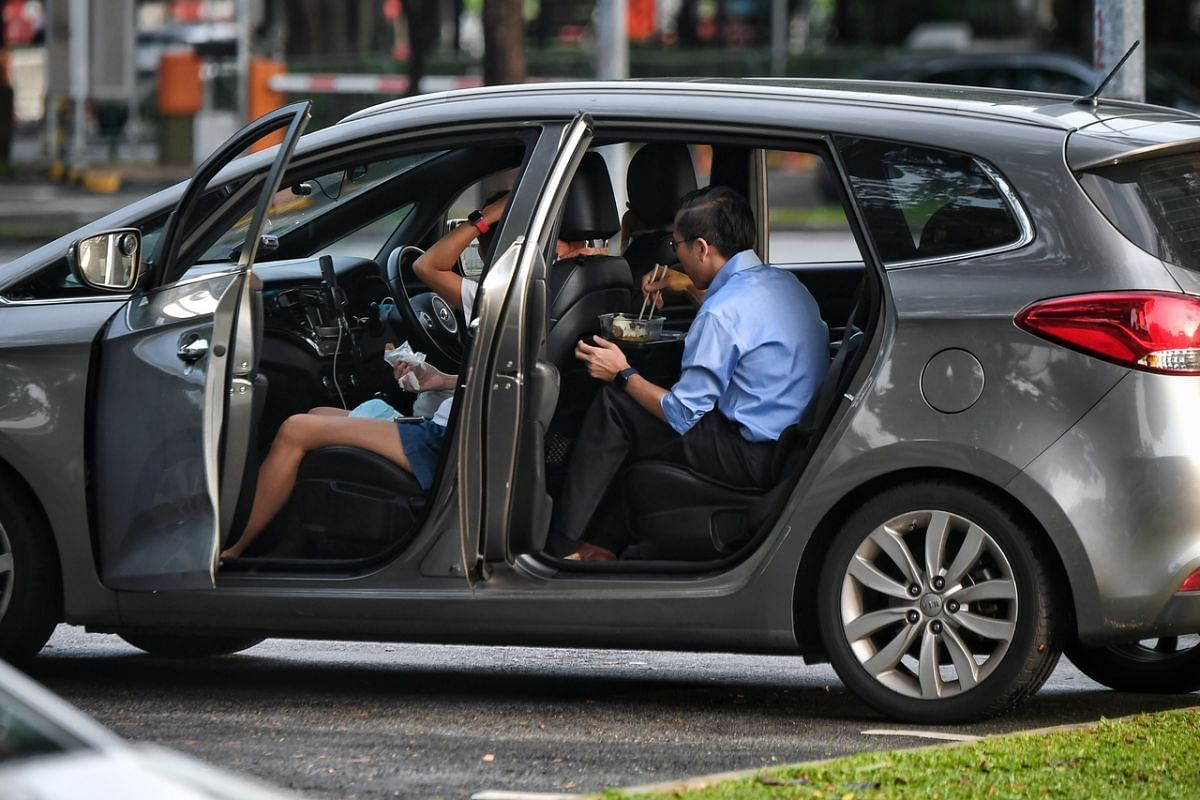 A couple having breakfast in their car at the carpark in Newton Hawker Centre at 7.30am on May 18, 2021.