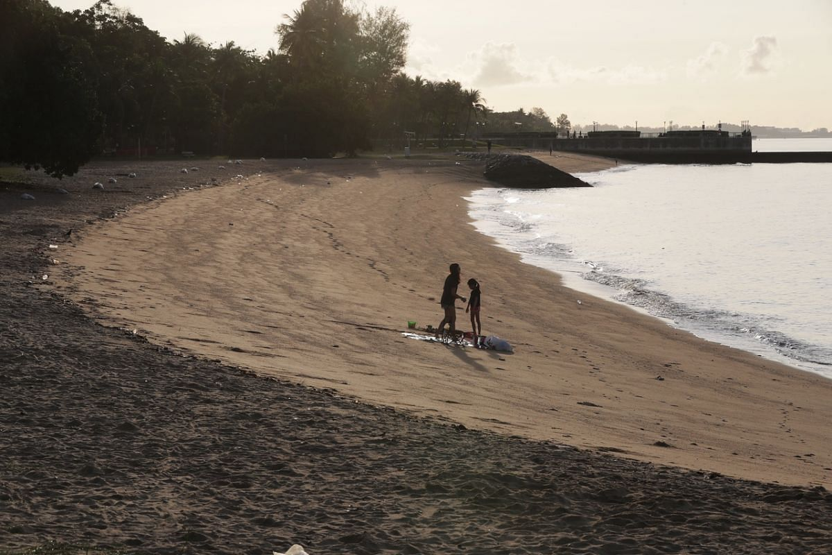 Two people have the whole stretch of beach at East Coast Park to themselves on a quiet Sunday on May 16, the first day of the phase 2 (heightened alert) measures.