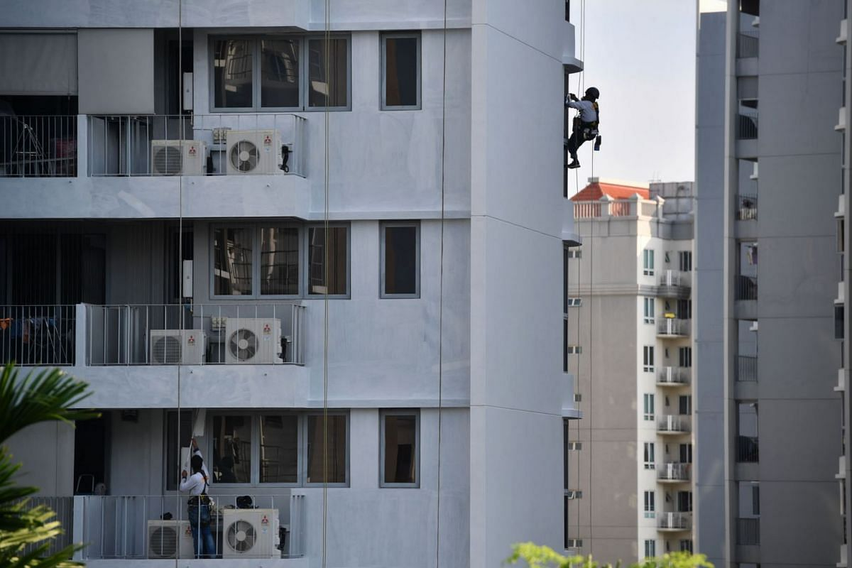 A labourer working from a height at a residential estate in Tampines on June 8, 2021.