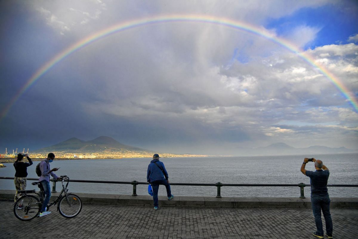 A rainbow appears in the sky over Naples with Mount Vesuvius in the background, in Naples, Italy, on June 8, 2021.
