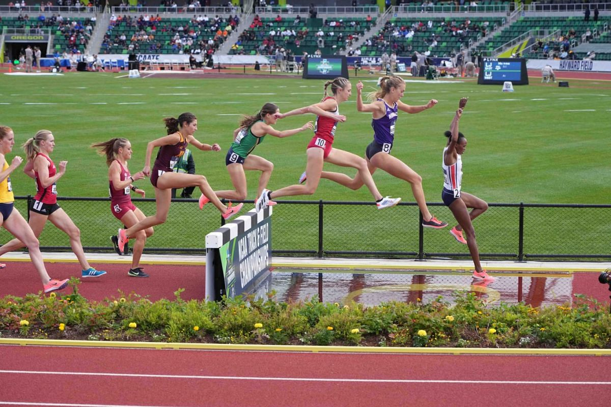 A general overall view as runners race over the water jump in a women's steeplechase heat during the NCAA Track and Field Championships at Hayward Field on June 10, 2021, in Eugene, Oregon, USA.
